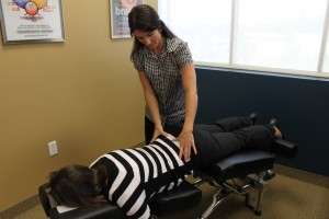 pregnant woman getting back adjusted